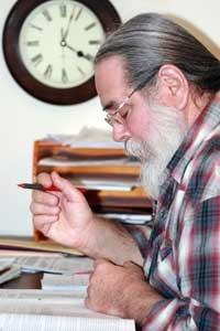 Doctor Joseph Thomas formulating Horse Health Herbs