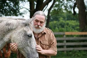 Doctor Joseph Thomas examining horse